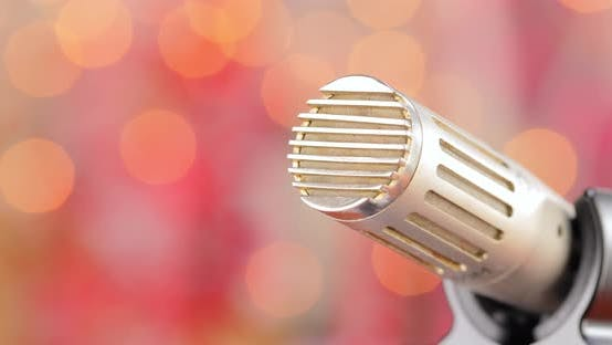 Thumbnail for Microphone on Stage Against a Blurry Light ,Blurry Background.
