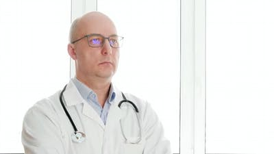 Confident Doctor in Eyeglasses Nodding Head