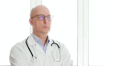 Confident Doctor in Eyeglasses Nodding Head