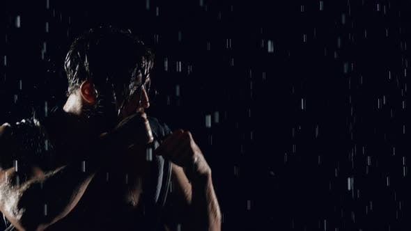 Thumbnail for Athletic Man Boxing In The Rain
