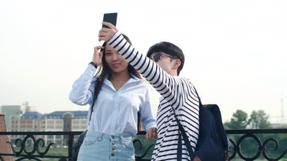 Thumbnail for Asian Teenagers Taking Selfie at Riverside