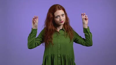 Pretty Woman with Red Hair Showing with Hands and Two Fingers Air Quotes Gesture Bend Fingers