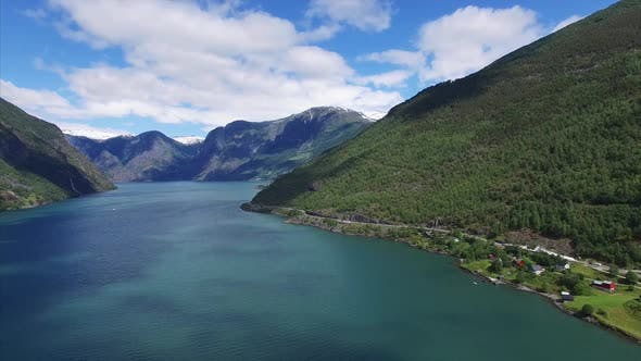 Thumbnail for Panning aerial view above fjord in Norway.