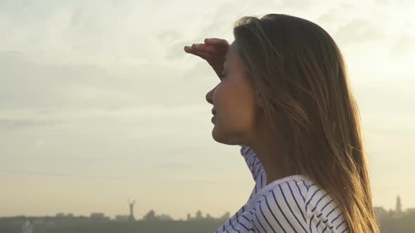 Thumbnail for Cute Girl Looking Into the Distance of the City