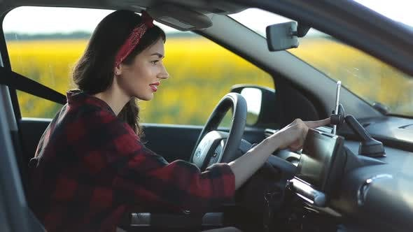 Thumbnail for Woman Using Navigation App on Smartphone in Car