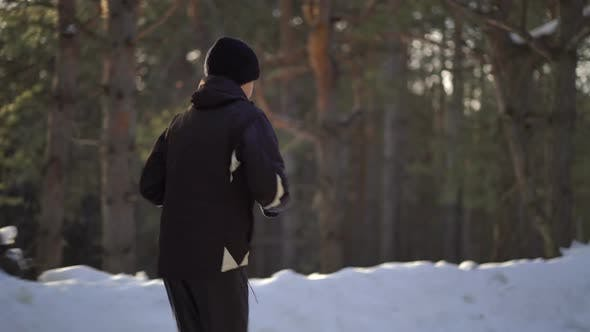 Thumbnail for Young Male Athlete Jogging In Wintry Wood