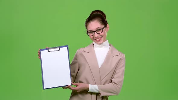 Thumbnail for Girl Advertising Agent Shows Important Information on the Tablet. Green Screen. Slow Motion