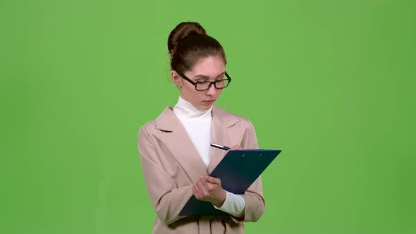 Thumbnail for Manager Fills the Questionnaire with a Pen on a Paper Tablet. Green Screen. Slow Motion