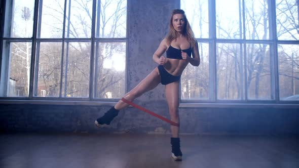 Thumbnail for Fimale Athlete Training Legs Using Resistance Band