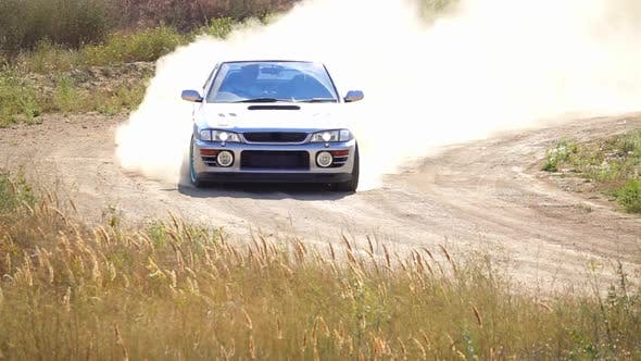 Thumbnail for Sports Car With a Cloud of Dust on the Bend of the Rally Track