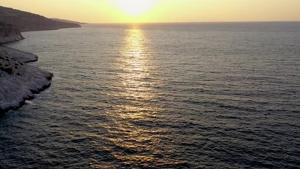 Thumbnail for Flying Over the Sea During the Sunrise Near the Rocky Coastline of Thassos