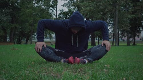 Sportive man is stretching outdoors