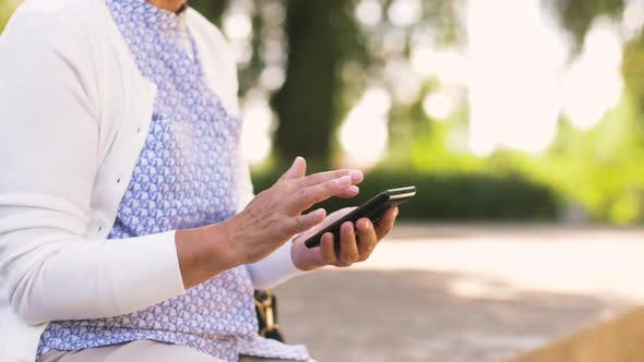 Thumbnail for Senior Woman with Smartphone at Summer Park 30