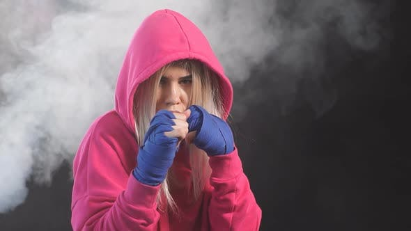 Thumbnail for Female Boxer Prepares to Punch at a Boxing Studio. Woman Boxer in Motion