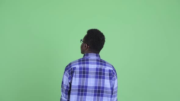 Thumbnail for Rear View of Young African Hipster Man Pointing Finger