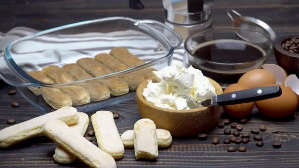 Cover Image for Ingredients for Making Traditional Italian Cake Tiramisu on Wooden Table