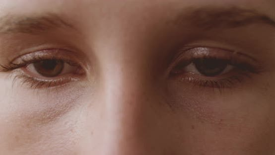 Depressed Young Woman'S Brown Eyes