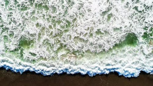 Big Waves Forming on a Crystal Clear Ocean