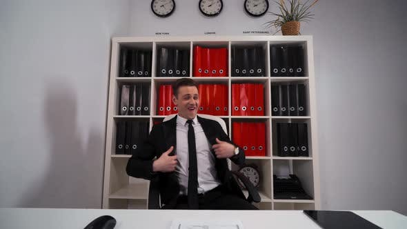 Thumbnail for Handsome Businessman Funny Dancing in Office Armchair