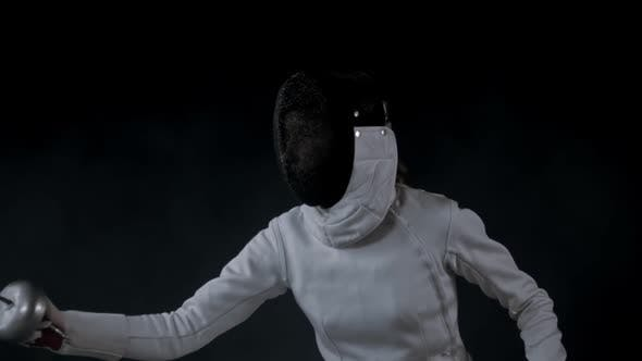 Thumbnail for Fencing Training in the Studio - Young Woman in White Costume Having a Duel
