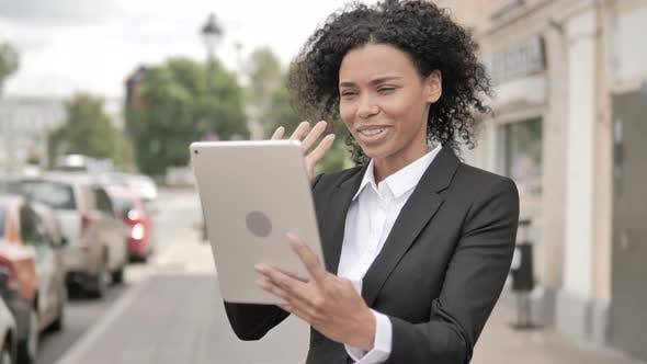 Thumbnail for Online Video Chat on Tablet by African Businesswoman, Standing Outdoor by Road