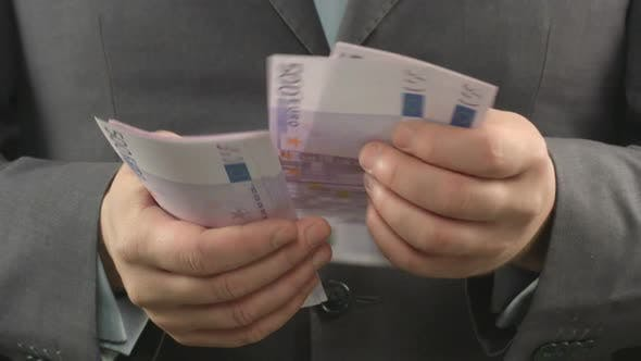 Thumbnail for Man in Grey Suit Counting Euros, Close up Of Businessman's Hands Holding Cash