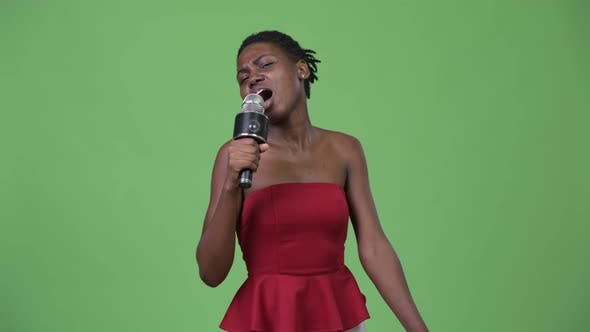 Young Beautiful African Woman Using Microphone