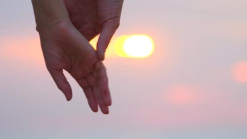 Man and woman holding hands over the sunset blur background. Couple trust Love and happiness