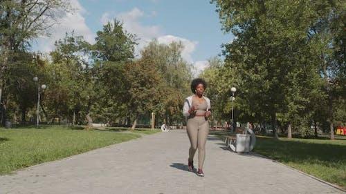 Plus Size Black Woman Jogging Outdoors