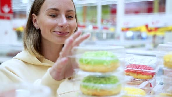 Thumbnail for Woman Buying Donuts In The Pastry Section