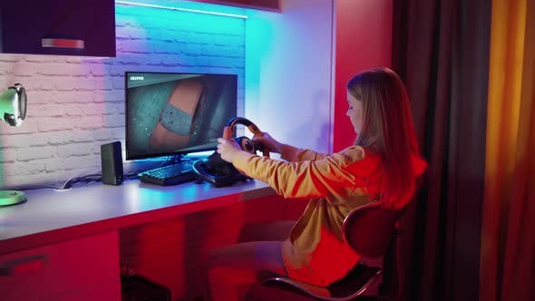 Attractive woman playing videogames. Professional gamer playing video games at home