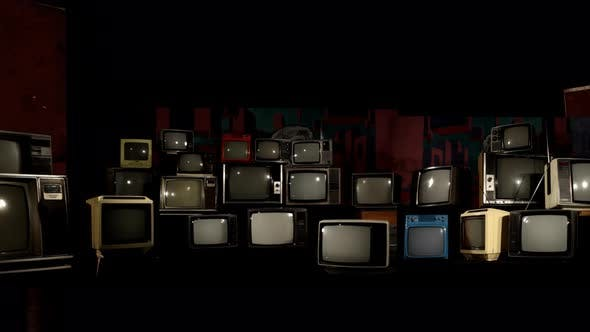 Cover Image for Many Broken Retro TVs.
