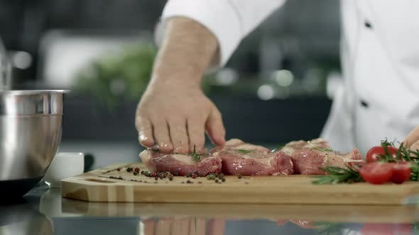 Thumbnail for Chef Male Preparing Meat at Kitchen. Closeup Chef Hands Preparing Steak.
