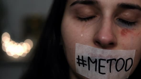 "Thumbnail for Portrait of a woman with a sticker on her mouth that says ""#metoo"". Me Too movement."