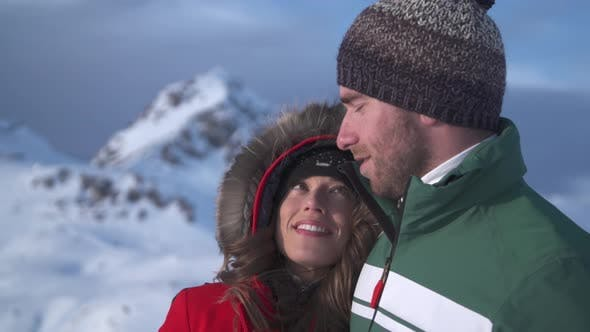 Thumbnail for A man and woman couple lifestyle in the snow at a ski resort.