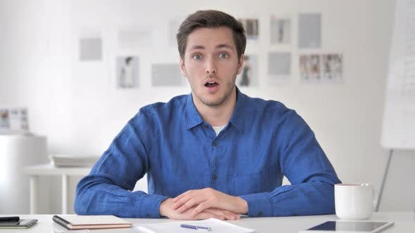 Thumbnail for Surprised Young Man At Work, Shocked
