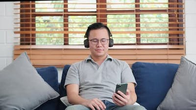 Man enjoys audio with smartphone