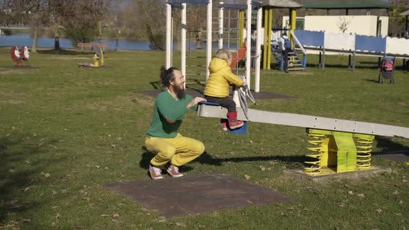 Thumbnail for Father and son playing at seesaw in public playground, Zagreb, Croatia.