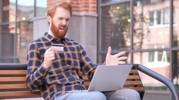 Thumbnail for Online Shopping Failure for Redhead Beard Young Man Sitting on Bench