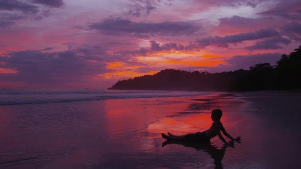 Thumbnail for Young boys sitting on beach at sunset, Costa Rica. Shot on RED EPIC for high quality 4K, UHD, Ultra