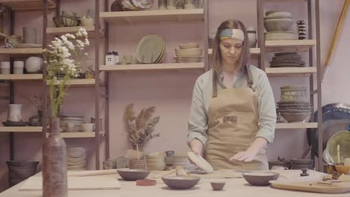 Woman Working Clay Using Rolling Pin