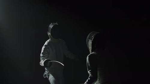 Two Professional Fencers Demonstrate Their Mastery of Foil Fencing