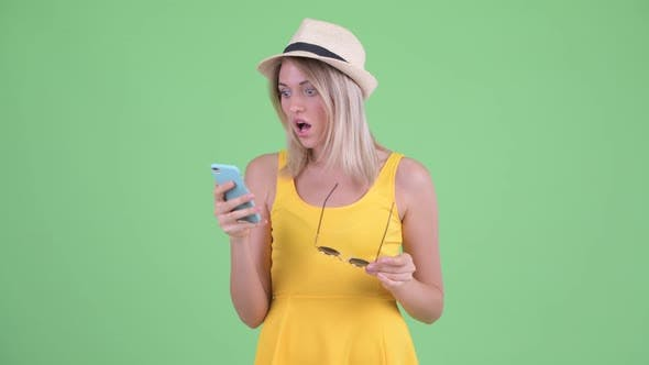 Thumbnail for Stressed Young Blonde Tourist Woman Using Phone and Getting Bad News