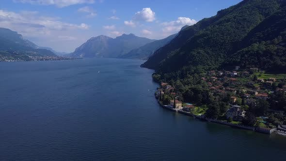 Thumbnail for Aerial Flying Over Mountain Lake Como in Italy, Lakeside Village and Beautiful Villas, Sunny Weather