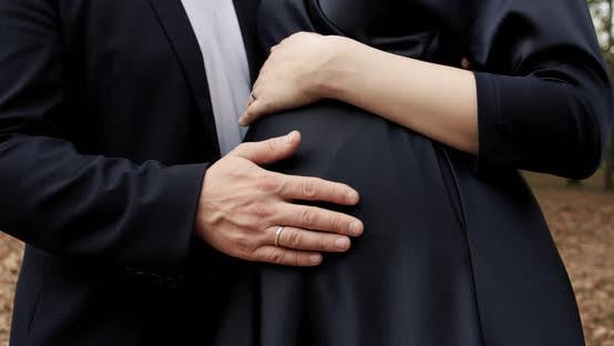 Pregnant Woman Holds Her Baby Belly Her Husband Hug Her Love Touches Her Swollen Belly