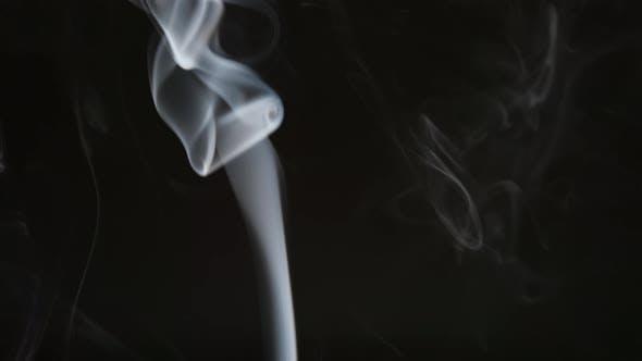 Smoke steam into cigarette smoke on a black background