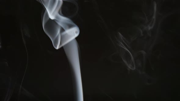 Smoke steam into cigarette smoke on a black background