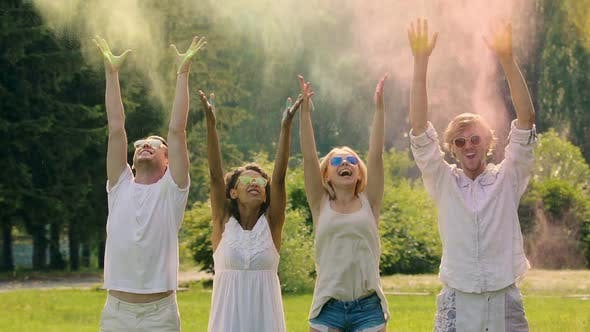 Cover Image for Four Young People Spraying the Colorful Powder in Extra Slow-Motion Holi Fest