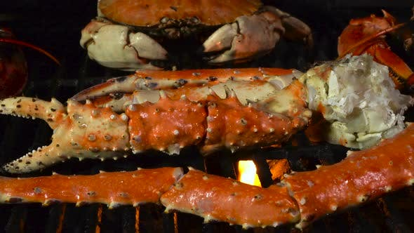 King Crab Legs and Dungeness Crab on the Grill with Butter