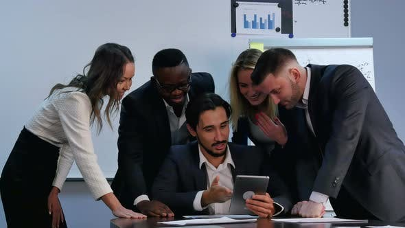 Thumbnail for Positive Business People Working with Digital Tablet in Office